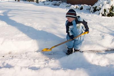 Ethan shovels the drive.
