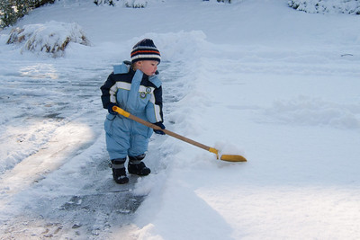 Ethan shovels the drive.