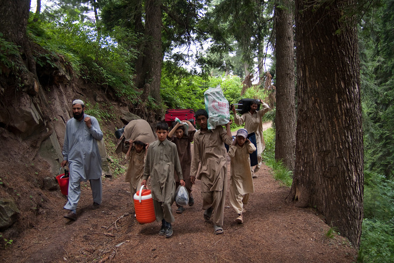 When we left the village, Javed and a bunch of students helped us carry all our stuff to our car, which was parked at the bazaar an hour away. (The dirt road to the bazaar was blocked for vehicles by a wealthy landlord trying to extort money from local villagers.)