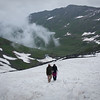 Erin and Ashraf, approaching the end of the snow field at around 14,000 ft, close to the top of the pass
