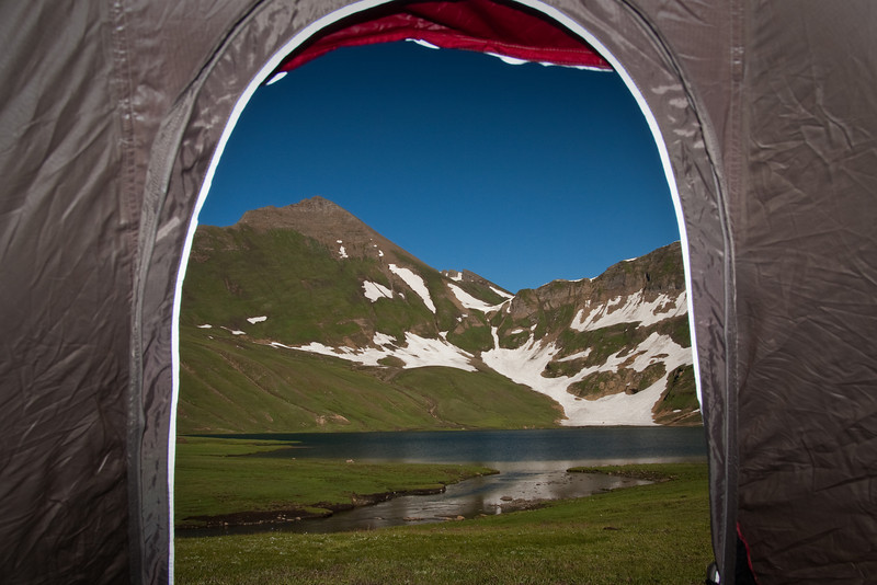 Room with a view: looking out through our tent doorway at Lake Dudipatsar. We camped here for three nights while we waited for my hiking boots to be taken back down to civilization, repaired, and brought back up. It was a beautiful place to be stuck!