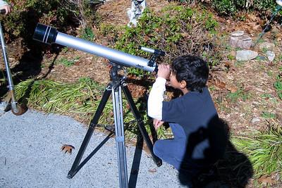 Jonathan looks through the telescope