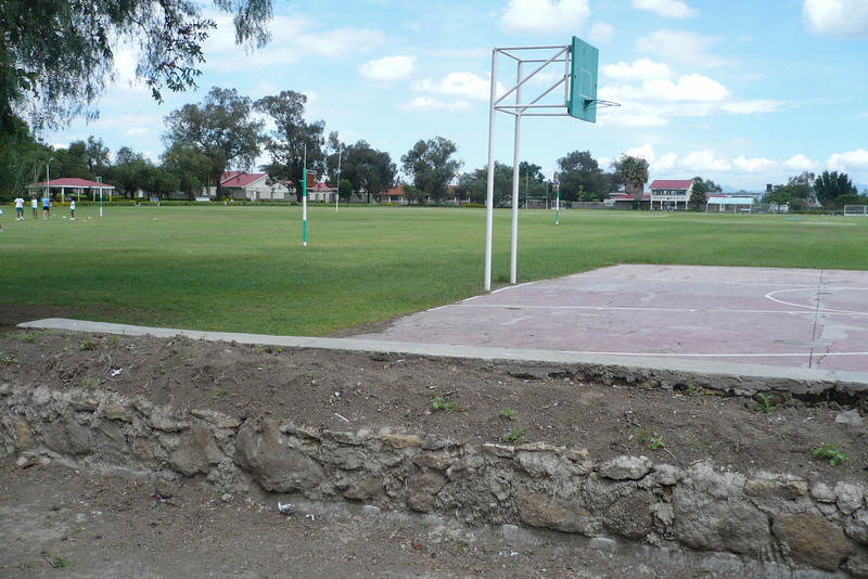"""It must be rugby term cause the rugby posts were up. And the basketball court is still there. In the distance on the right is the new swimming pool complex, and just left of center is the Form Six buildings. By the way, words like prep school, senior school, Forms 1-6 etc. are no longer used at Greensteds. Now they talk about """"Year 1-Year 13."""""""