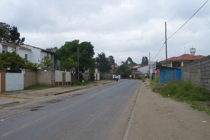 Mbaruk Road, in front of our old Golf Course house, looking away from Kenyatta Market. On the right there used to be a field where I would play football every evening and where there were a couple of kiosks; now there's a big housing estate there.