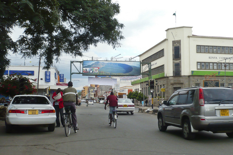 """Downtown Nakuru in 2011 - the traffic light still doesn't work. The license plate on the car on the right is """"KBD;"""" we even saw """"KBN"""" cars (like """"KBN123A"""" or whatever)."""