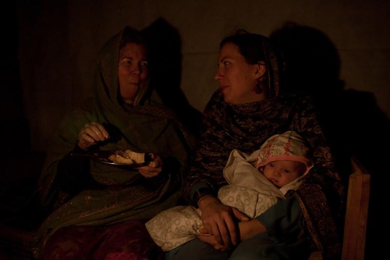 Mom and Erin enjoying dinner, and Sienna enjoying the fire...
