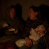 Mom and Erin enjoying dinner, and Sienna enjoying the fire...