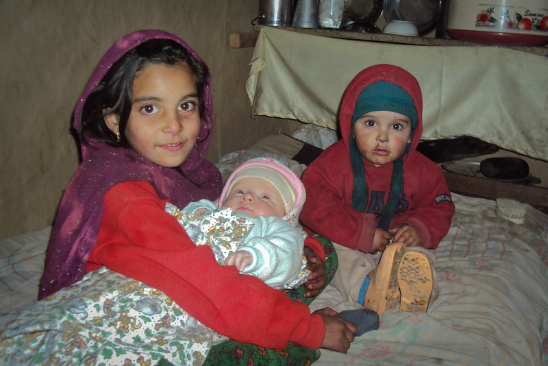 Two of our host's kids: Amna holding Sienna, while Farhad looks on