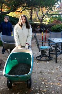 Alison taking topsoil to the Secret Garden