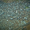 Flying over a crowded slum, somewhere on the outskirts of Nairobi
