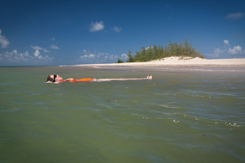 Relaxing in the water by the empty little island