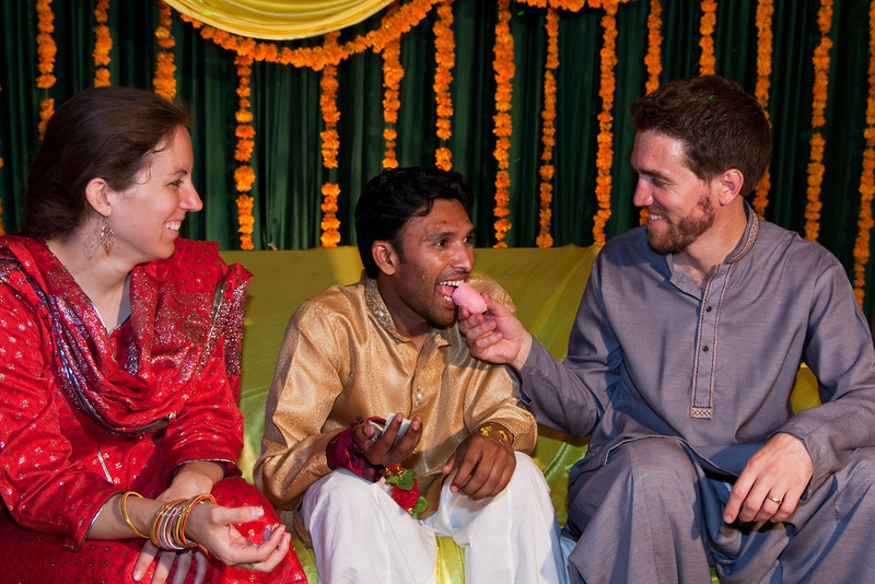 An important ritual during day 1 of the wedding (the Mehndi) is for each guest to feed the groom a piece of candy.