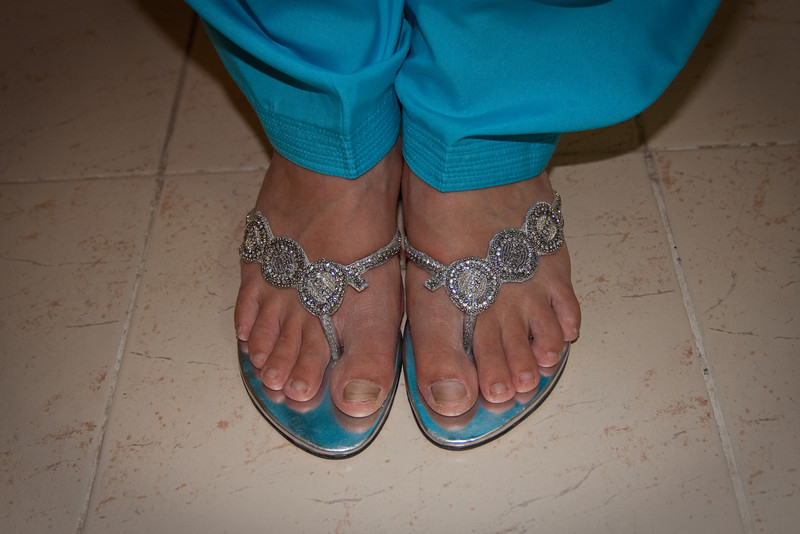 Erin bought some fancy, pretty sandals for the wedding.