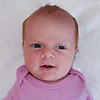Today we took a photo for Sienna's passport. Actually we took about 37,000 photos, and these are the only 3 that were even remotely usable. Have you ever tried getting a 4-week old baby to pose for a picture, lying on a sheet on the floor, wide awake with both eyes open, flash in her eyes, no crying, no hands in the frame, and face straight ahead so that both ears are visible? I mean, even when she's looking straight at you you can hardly see either of her ears! I hope the State Department likes her yellow and white ducky suit...