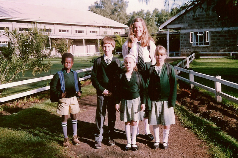 I believe this was our first day of school at Greensteds, in September 1992? I started parting my hair soon after that :-) Behind us is the school office and the New Hall.