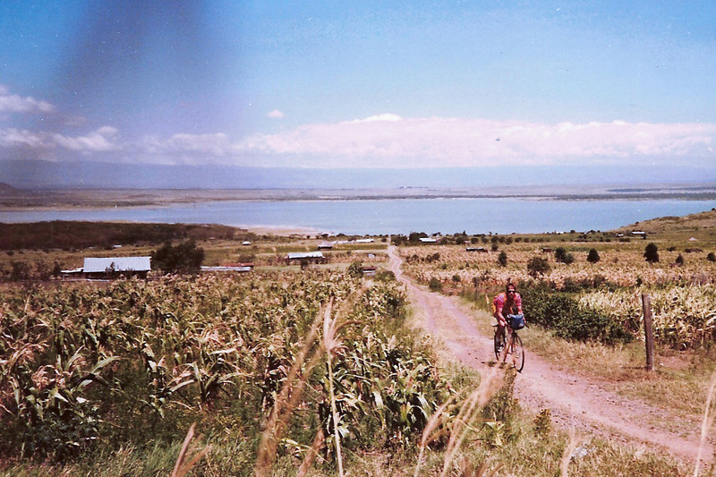 Dad riding on a dirt road (just for the picture, right!?) in front of Lake Elementaita, c.1989-1991?