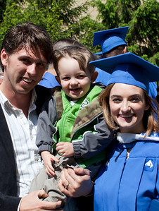 Jill poses for some photos with family after walking during the EIU Spring Commencement held in the Lantz Gym on the campus of Eastern Illinois University on May 7, 2011. (Jay Grabiec)