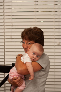 Savannah relaxing in Grandma's arms at the end of the day.
