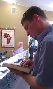 Jake reading Bible at church