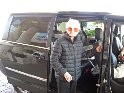 Mom is looking very stylish in her black down jacket gettin into her black limo... Where's the photo of Tim with his chauffer's cap?