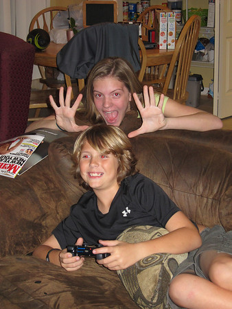 January 18, 2012-Patrick playing the PS3 and Sarah sneaking up behind him being goofy!!