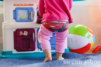 12-01-2012  Lilla has been obsessed with Evan's undies for a long time.   She actually picked her feet up one at a time to get these put on.  There is another pair under there too!