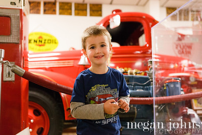 "11-20-2011  Behind Evan is ""Red.""  An old fire truck like the one in the Cars movie.  This was in the antique part of the Don Garlits museum."