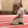 Our guide demostrates prayer (sorry about the blur)