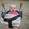 Sienna thoroughly enjoyed her first ride on a swing. We had to buffer her in there with folded blankets.