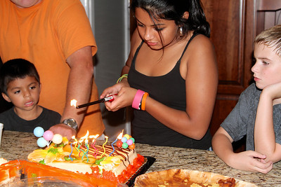 Jackie lights the candles on her Mom's birthday cake