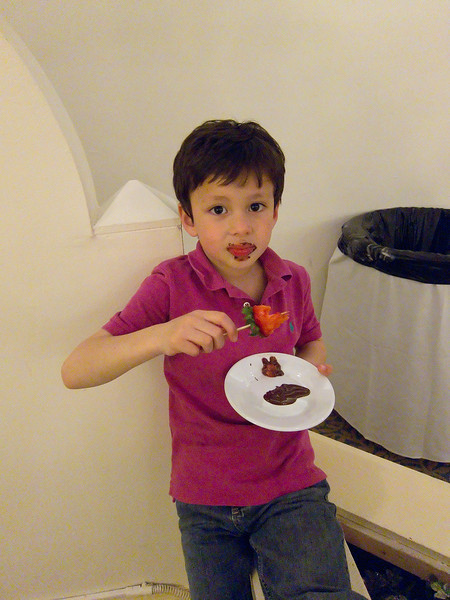 Matthew made a mess of his face and shirt. He seemed totally oblivious to the chocolate dripping down his body.