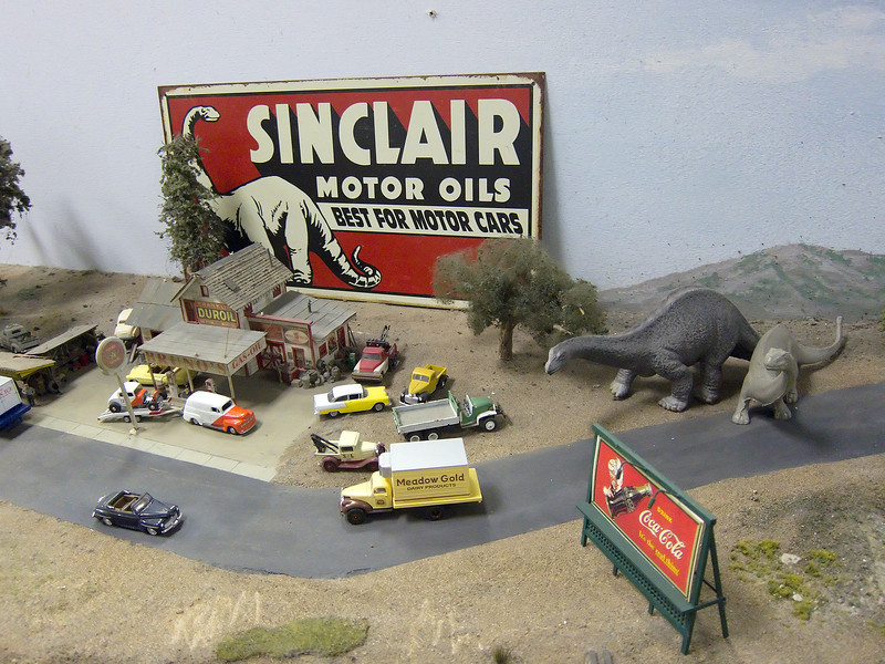 I would stop here for gas if I saw massive dinasours blocking the road!