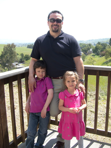 Large strange man in black with two children.