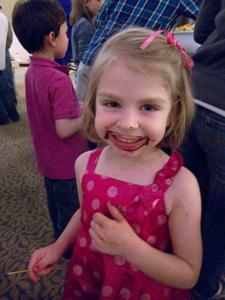 Lucy's smile has been naturally enhanced with chocolate!