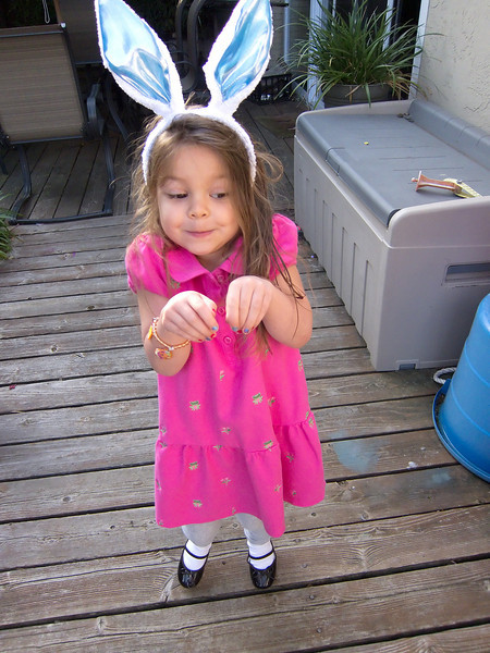 Claire in her Easter outfit and Easter bunny ears.