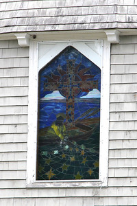 Stained glass on front of church.
