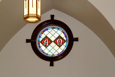Simple. yet lovely, stained glass over the altar.