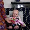 Enjoying her toys (5 months)