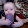 Sienna at 7 months: she really likes cups. And standing. Here she's enjoying both.