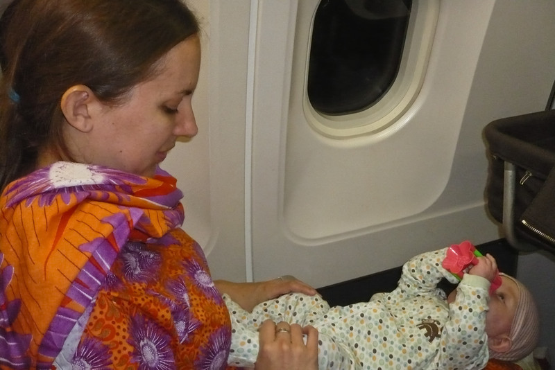 Enjoying her toy on the plane