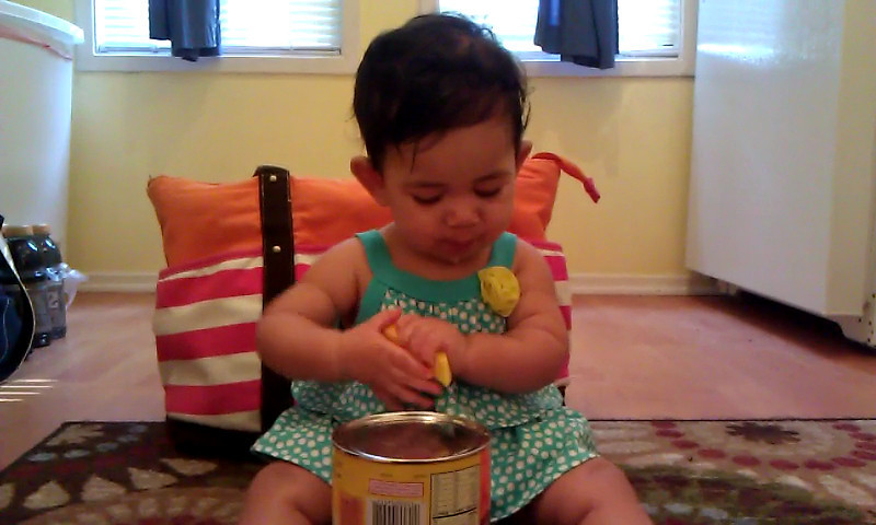 Eating (licking) a mango slice. 8/16.