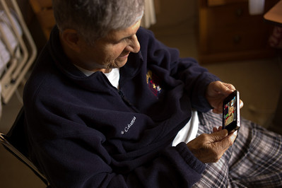 Papa Charlie looking at photos of Henry in his rehab center in Orland, Illinois on February 17, 2012. (Jay Grabiec)