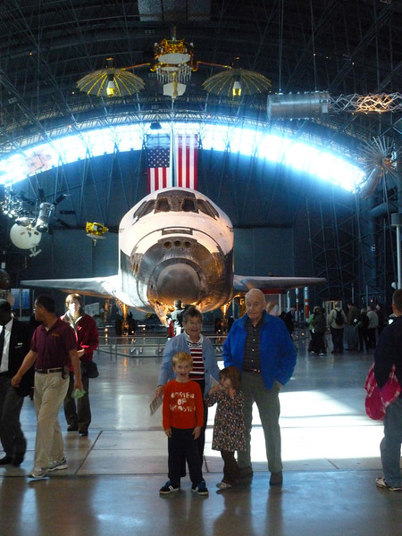 With Grandma Mary and Grandpa Ken at the Air and Space Museum in front of Space Shuttle Discovery 2012.