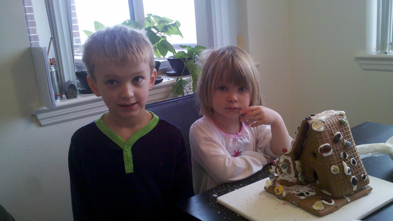 Construction of the 2012 gingerbread house...moments before Zia ate all the candy off of it.