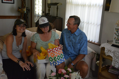 Carol checks out her surprise from Summer and Tim.