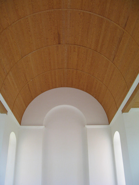 wooden barrel vault ceiling and plaster walls