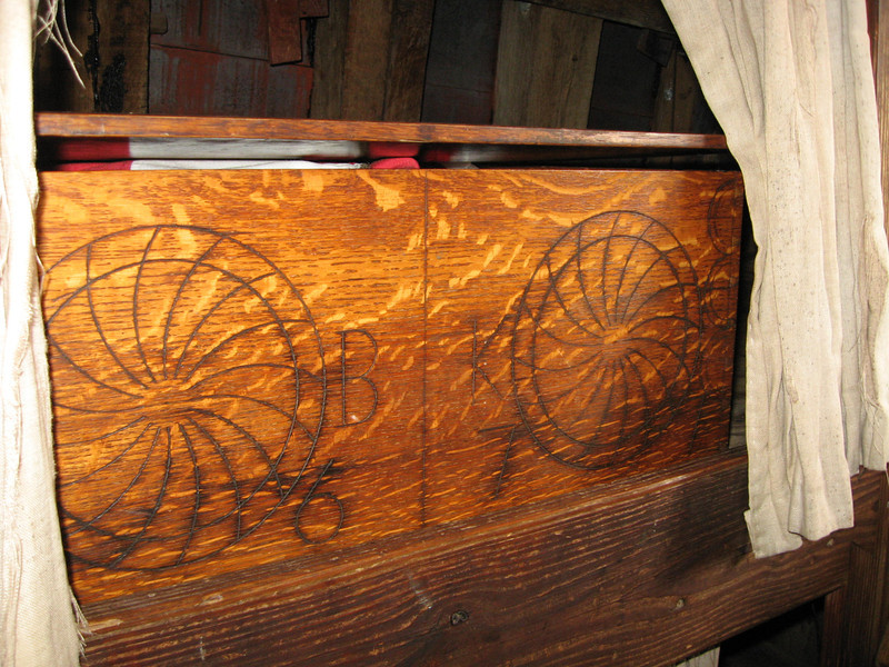 another bunk area in the stern - holding a blanket box