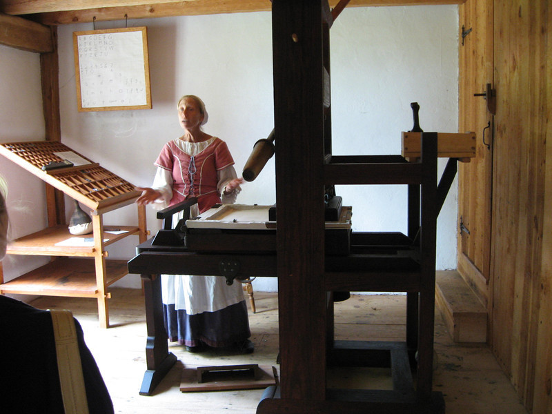 a reenactor explaing how the printing press worked