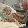 Frank giving Elaine a drink. Presbyterian Hospital, Charlotte, NC, 9/11/2013, (she died 9/25/2013) Linda's camera