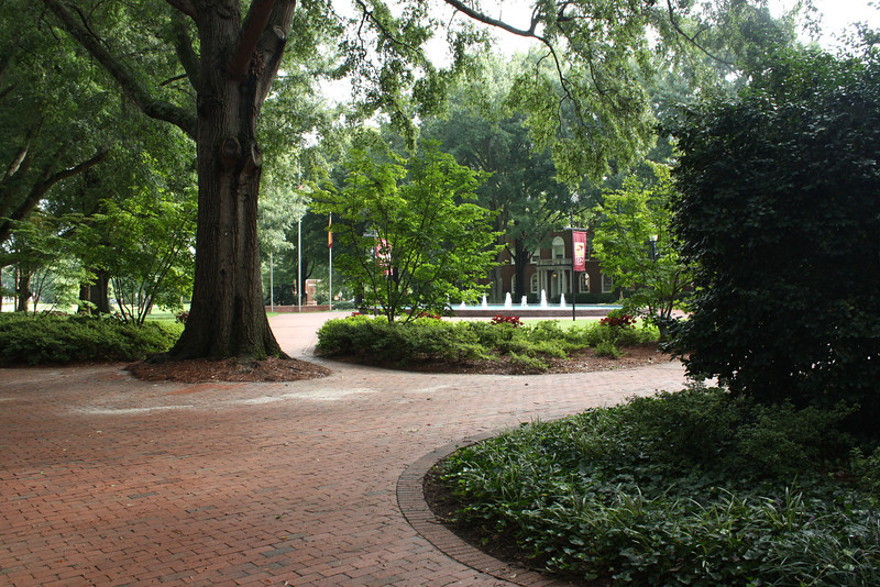 Walking toward Fonville Fountain from Sloan/Virginia/West residence halls.  The fountain is in front of the Alamance building, which houses administrative offices.